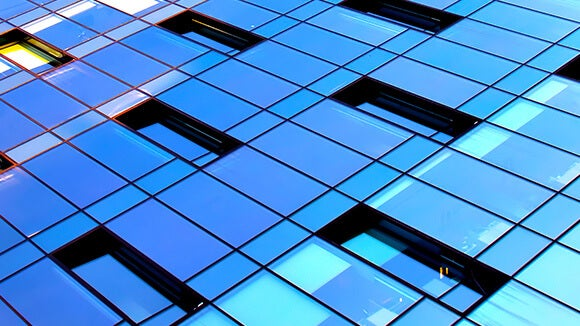 glass windows reflecting blue sky