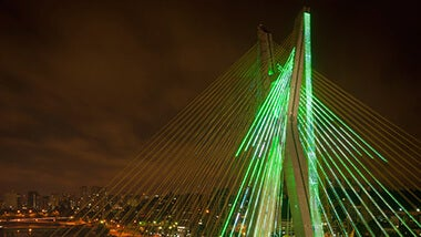 green bridge lit up at night